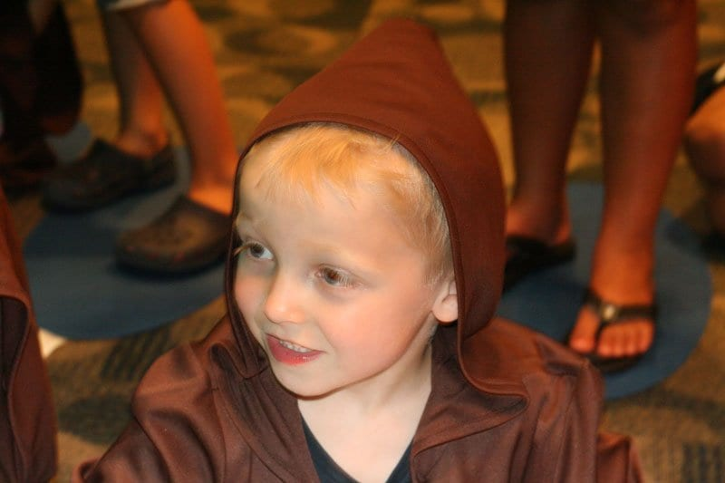 child waiting for instructions at Jedi Training Academy in Walt Disney World Hollywood Studios