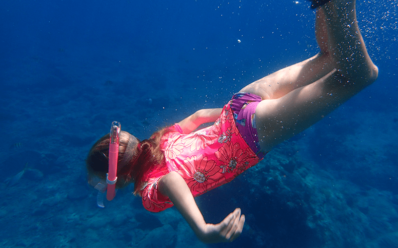 girl snorkelling underwater in the British Virgin Islands
