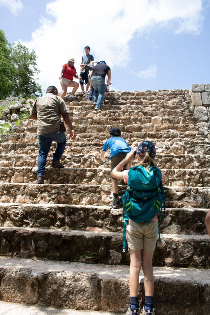 climbing up to the governors palace in uxmal