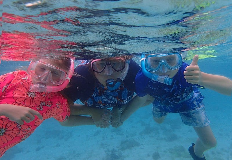 family snorkelling together