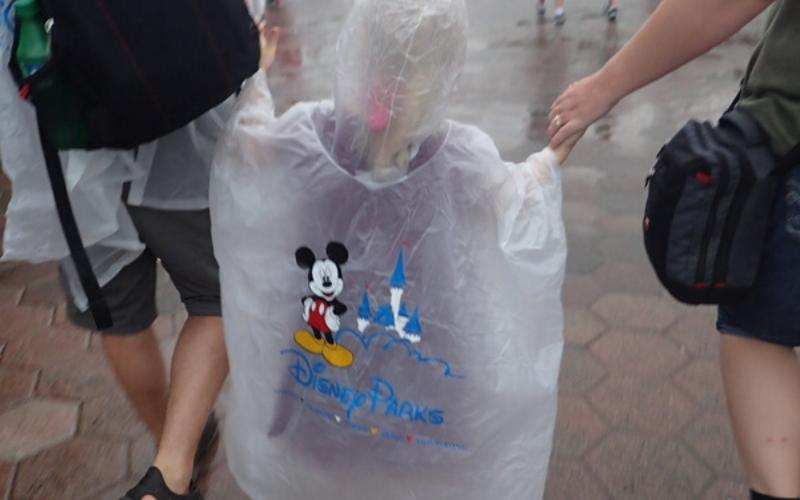 child and parents at magic kingdom in Walt Disney World Florida looking for activities and ideas to do whilst it rains