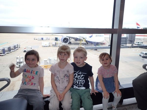 travelled so far kids at the airport before a long haul flight