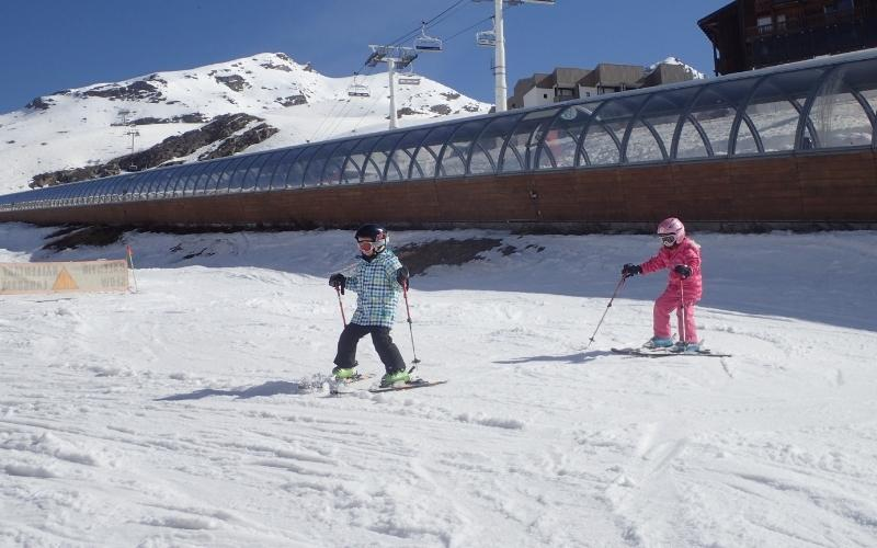 kids from travelled so far skiing in the spring sunshine in Val Thorens